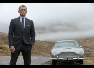 Daniel Craig and Aston Mart DB5 in a Skyfall publicity sill